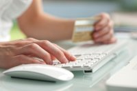 Close up shot of entering credit card number to make a purchase online